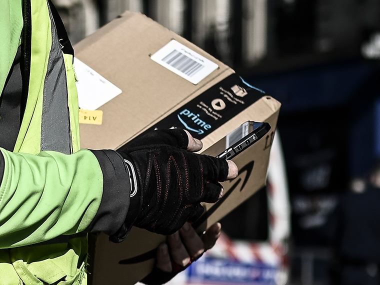 A delivery man delivers an Amazon package in Paris on March 19
