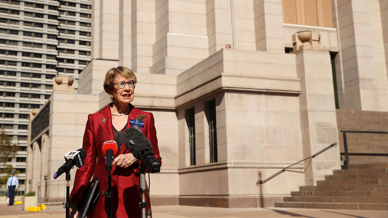 Margaret Beazley, Governor of New South Wales, speaks to the media in front of a near empty Anzac Memorial in Hyde Park in Sydney, Australia on April 25.