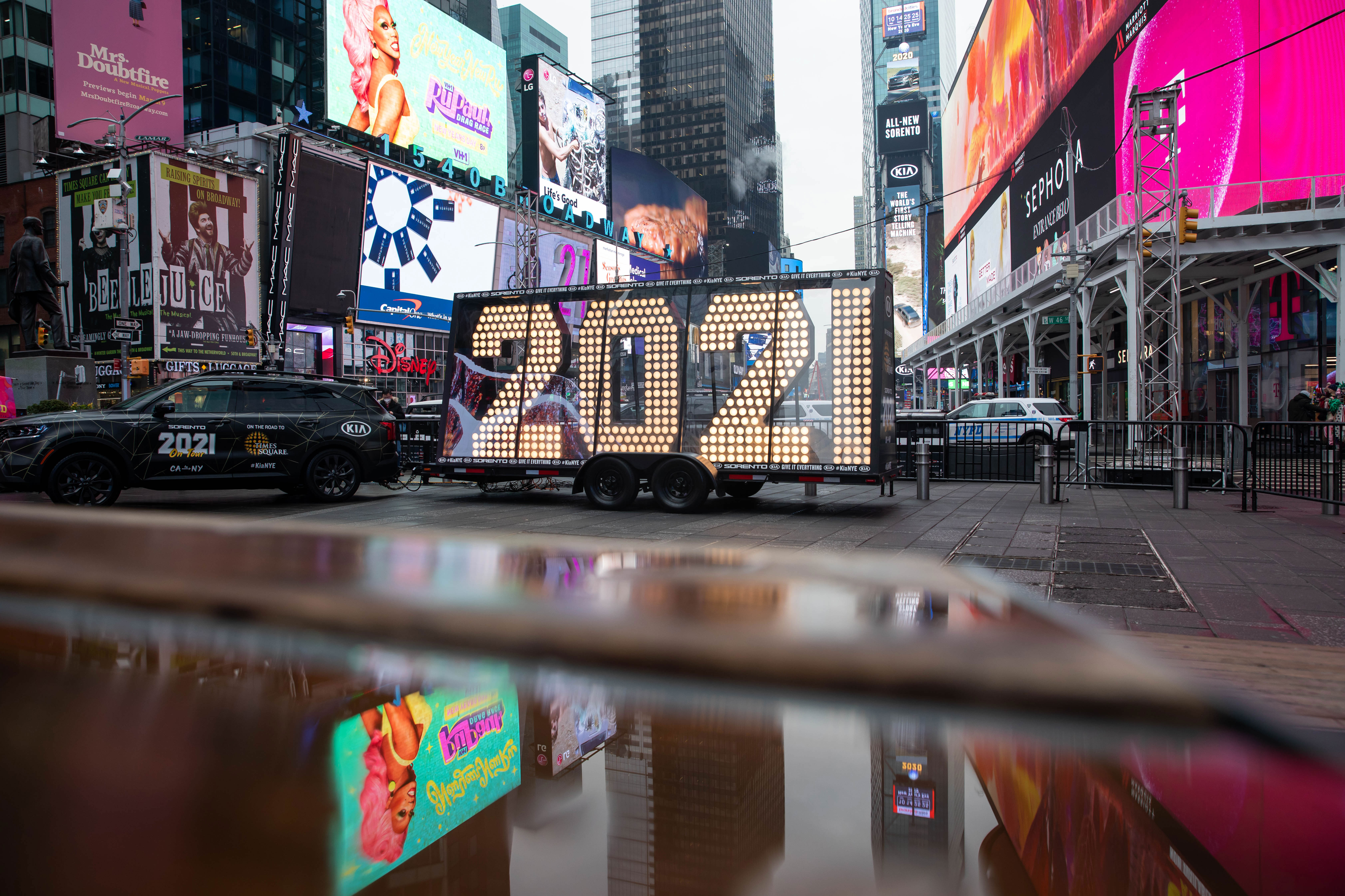 """An SUV delivers the """"2021"""" New Year's Eve numerals to Times Square in New York during a coast-to-coast tour on December 21."""