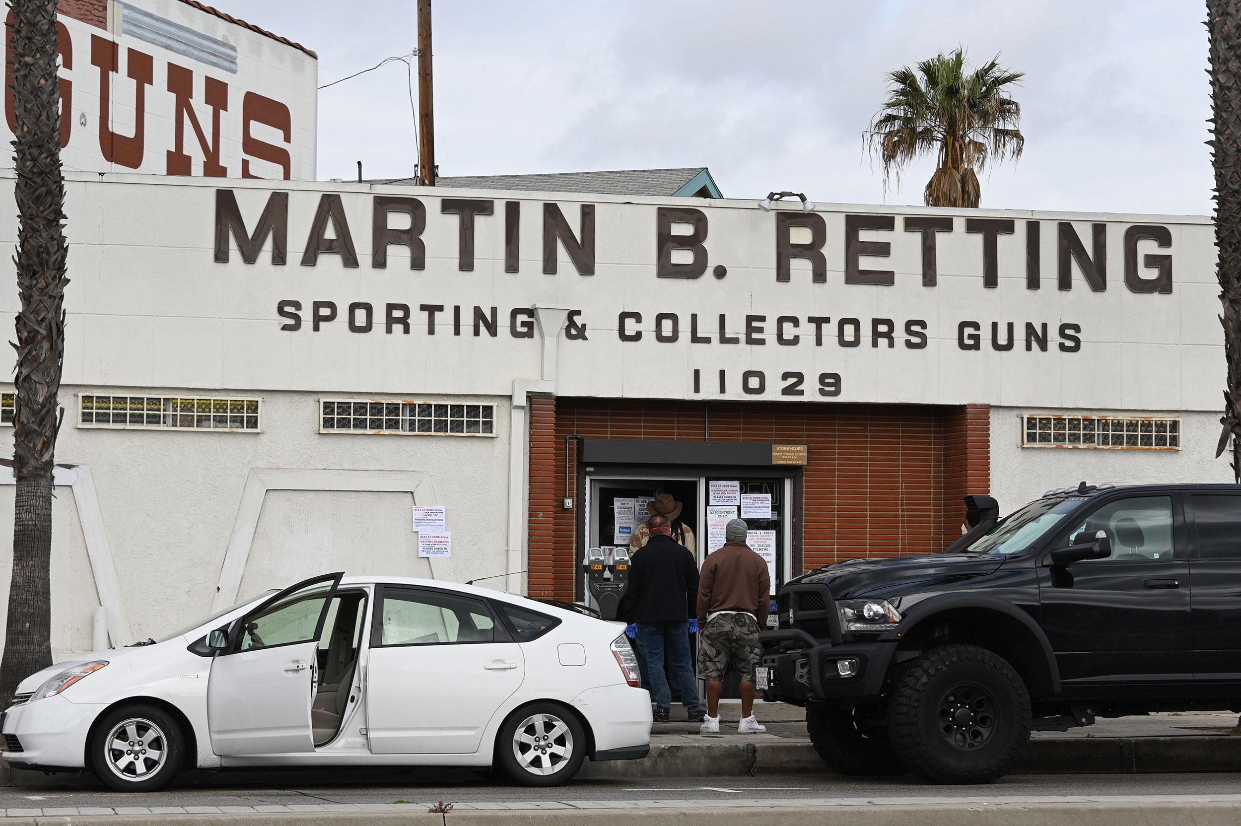 People wait in line at Martin B. Retting gun shop in Culver City, California, on March 24.