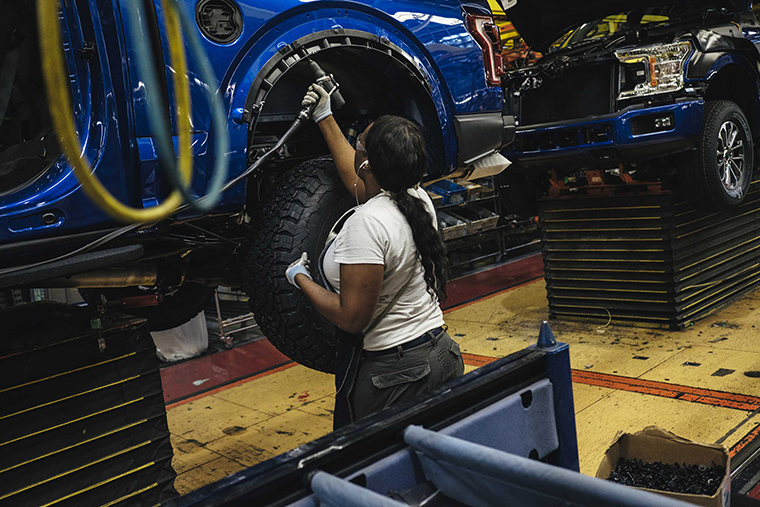 An employee works on the line at the Ford Motor Co. Dearborn Truck Plant in Dearborn, Michigan, U.S., on Thursday, Sept. 27, 2018.