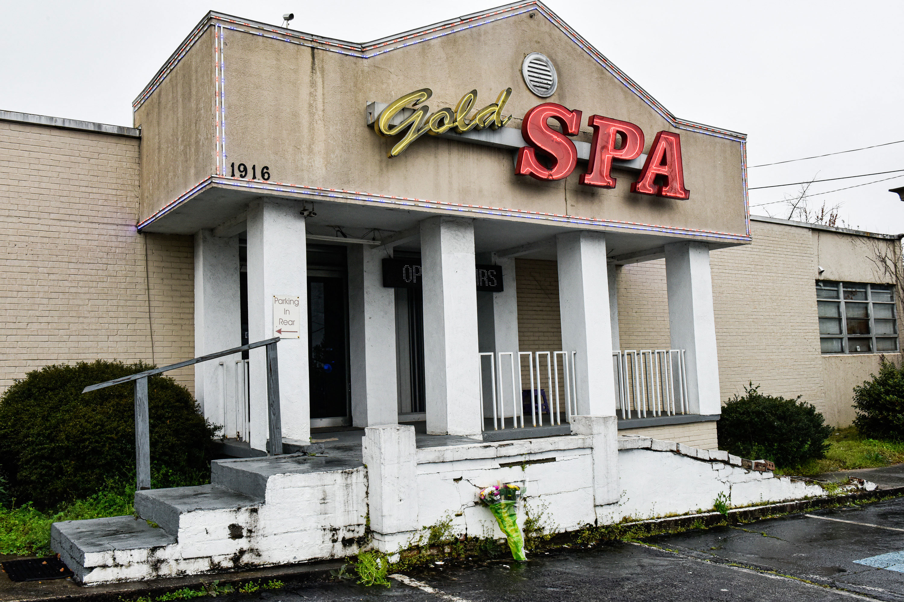 Flowers are seen at the entrance of Gold Spa in Atlanta on March 17.
