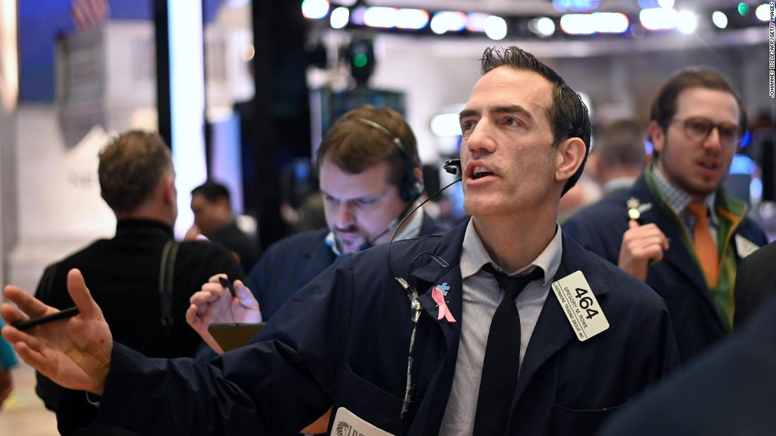 Traders work during the opening bell at the New York Stock Exchange (NYSE) on March 16, 2020.