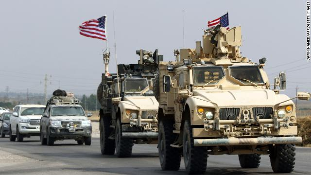 A CNN camera crew witnessed US armored vehicles carrying American troops through western Iraq