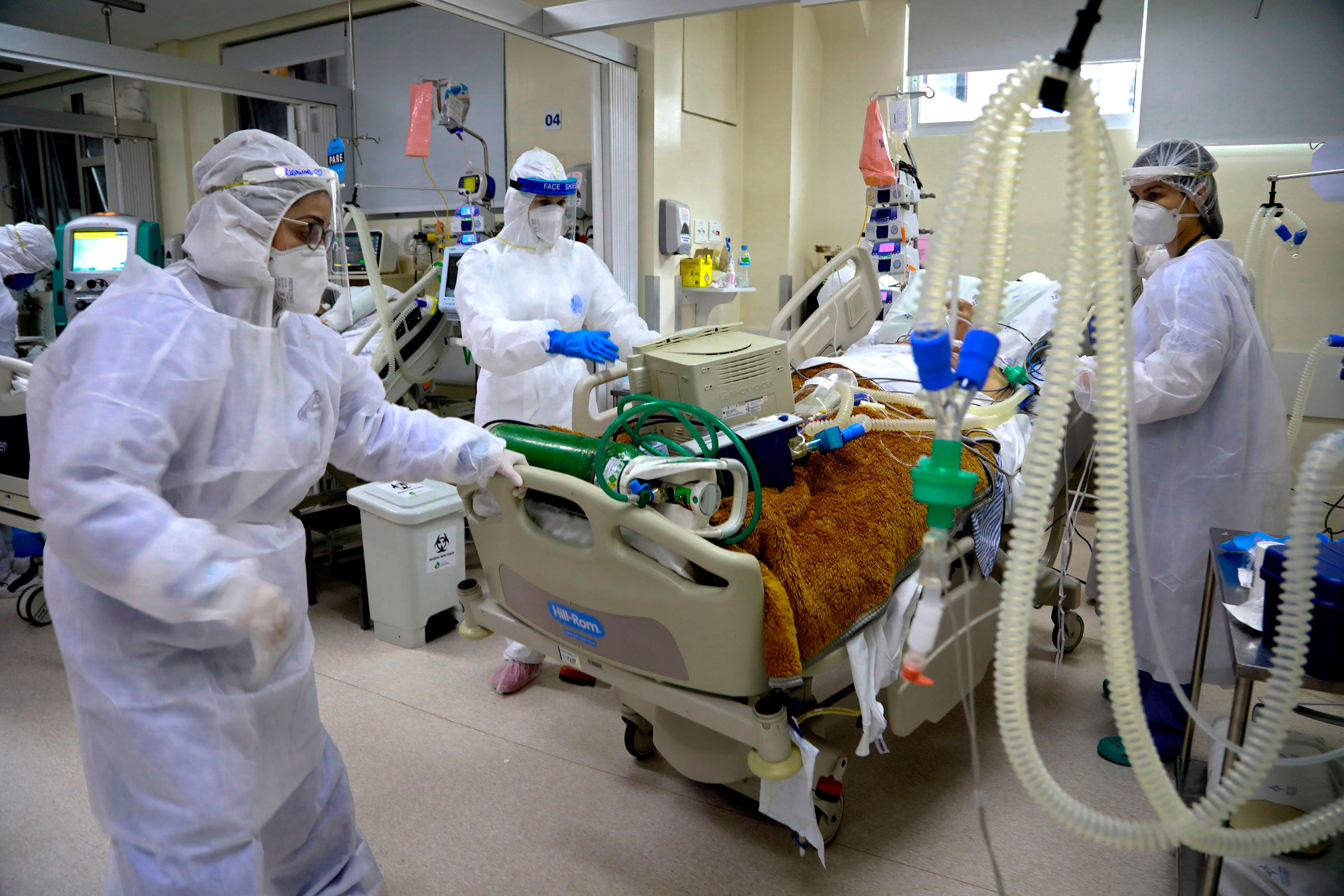 Medical personnel treat a coronavirus patient in the Intensive Care Unit of the Santa Casa de Misericordia Hospital on August 13 in Porto Alegre, Brazil.