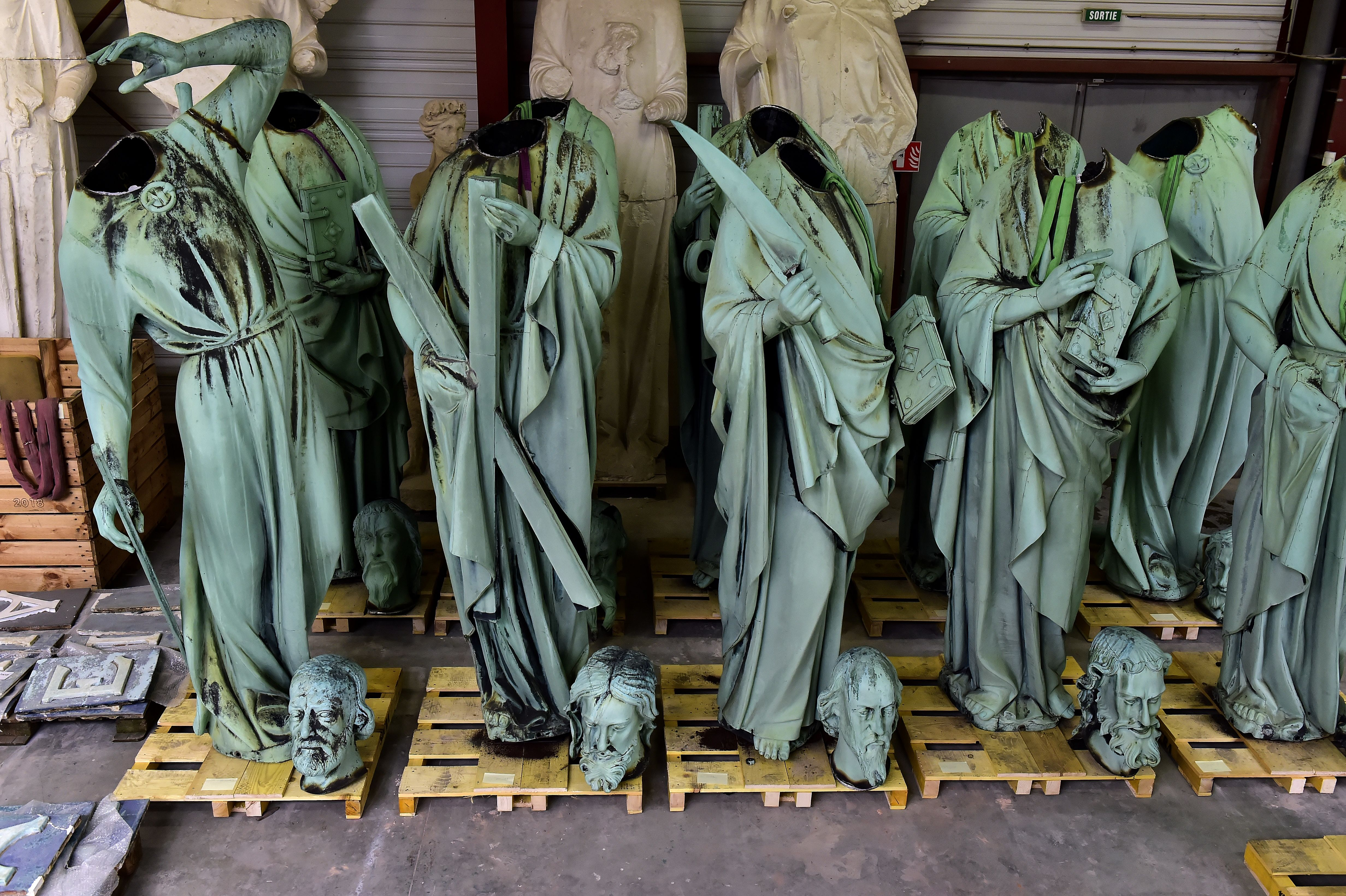 Statues which sat around the spire of the Notre-Dame cathedral stored in a workshop before restoration at Marsac-sur-Isle, near Bordeaux, on Tuesday.