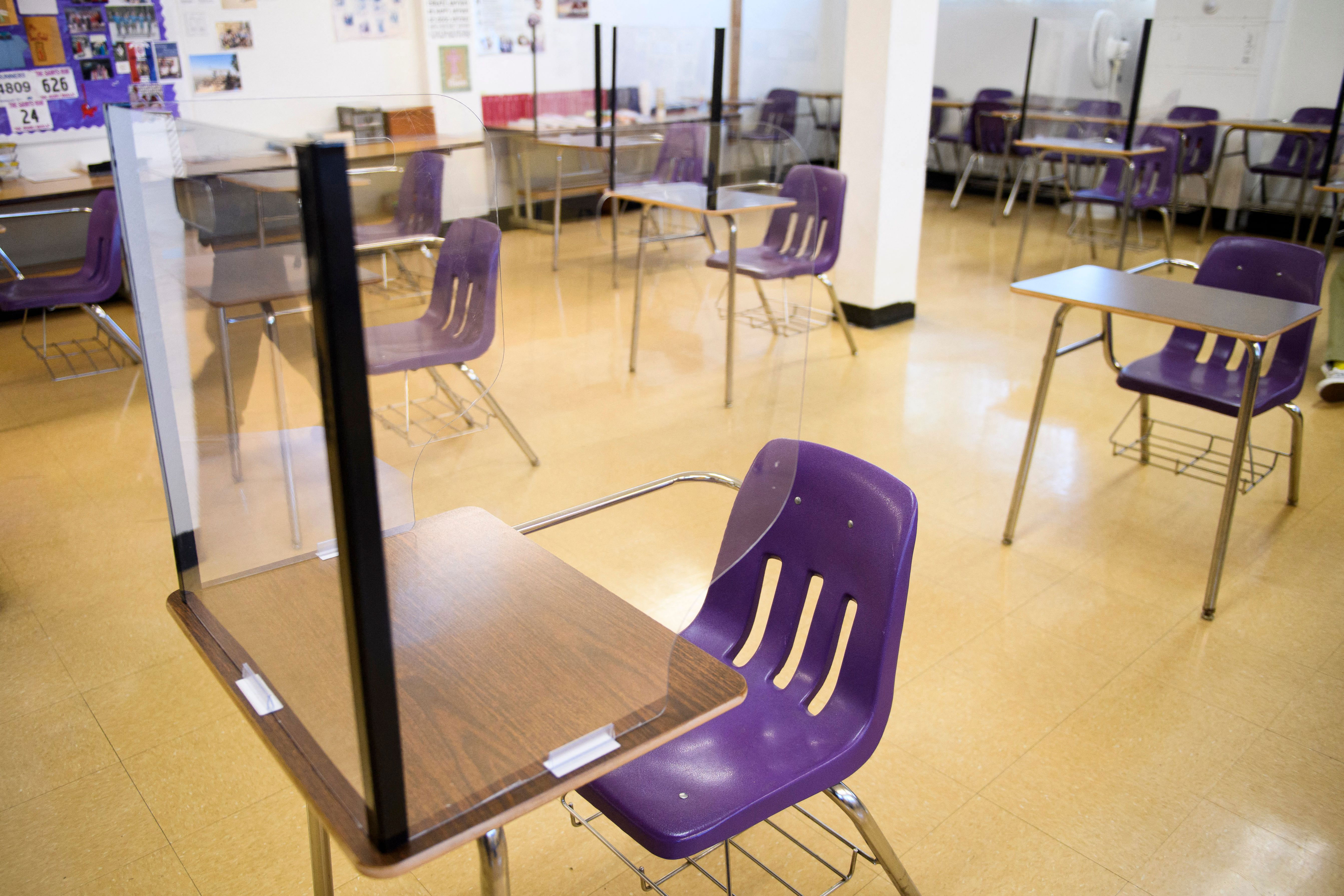 Plexiglass dividers surround desks at St. Anthony High School in Long Beach, California, on March 24.