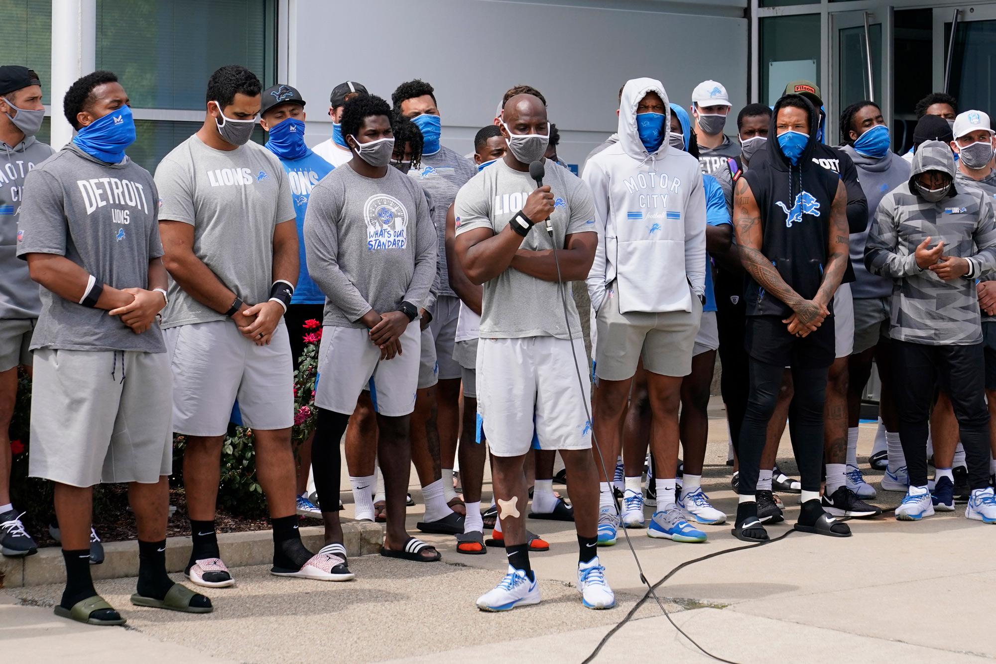 Detroit Lions safety Duron Harmon addresses the media with his teammates outside the Lions NFL football camp practice facility on August 25 in Allen Park, Michigan.