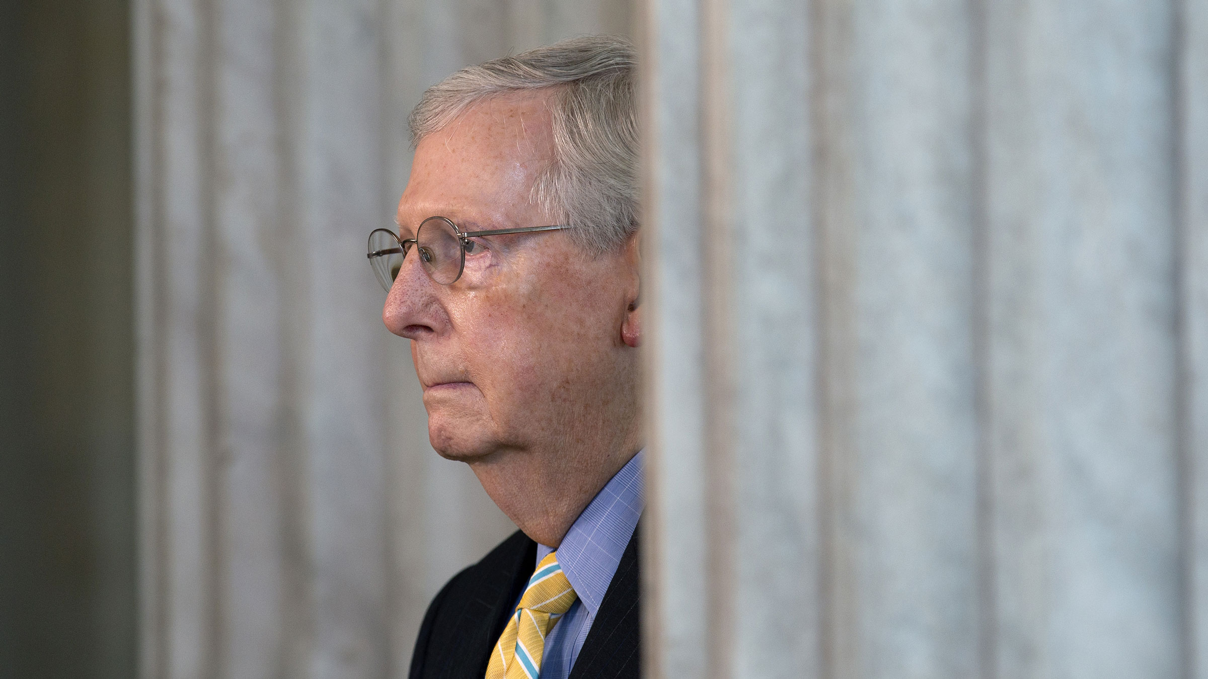 Senate Majority Leader Mitch McConnell pauses during a television interview on Tuesday.