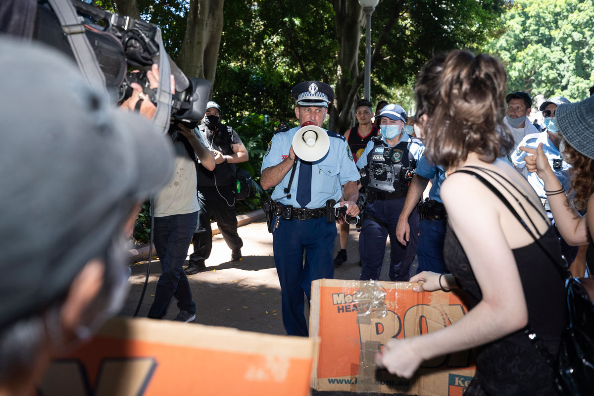 """Police confront protesters in Hyde Park after the main section of the """"Invasion Day"""" Rally had ended on January 26 in Sydney, Australia."""