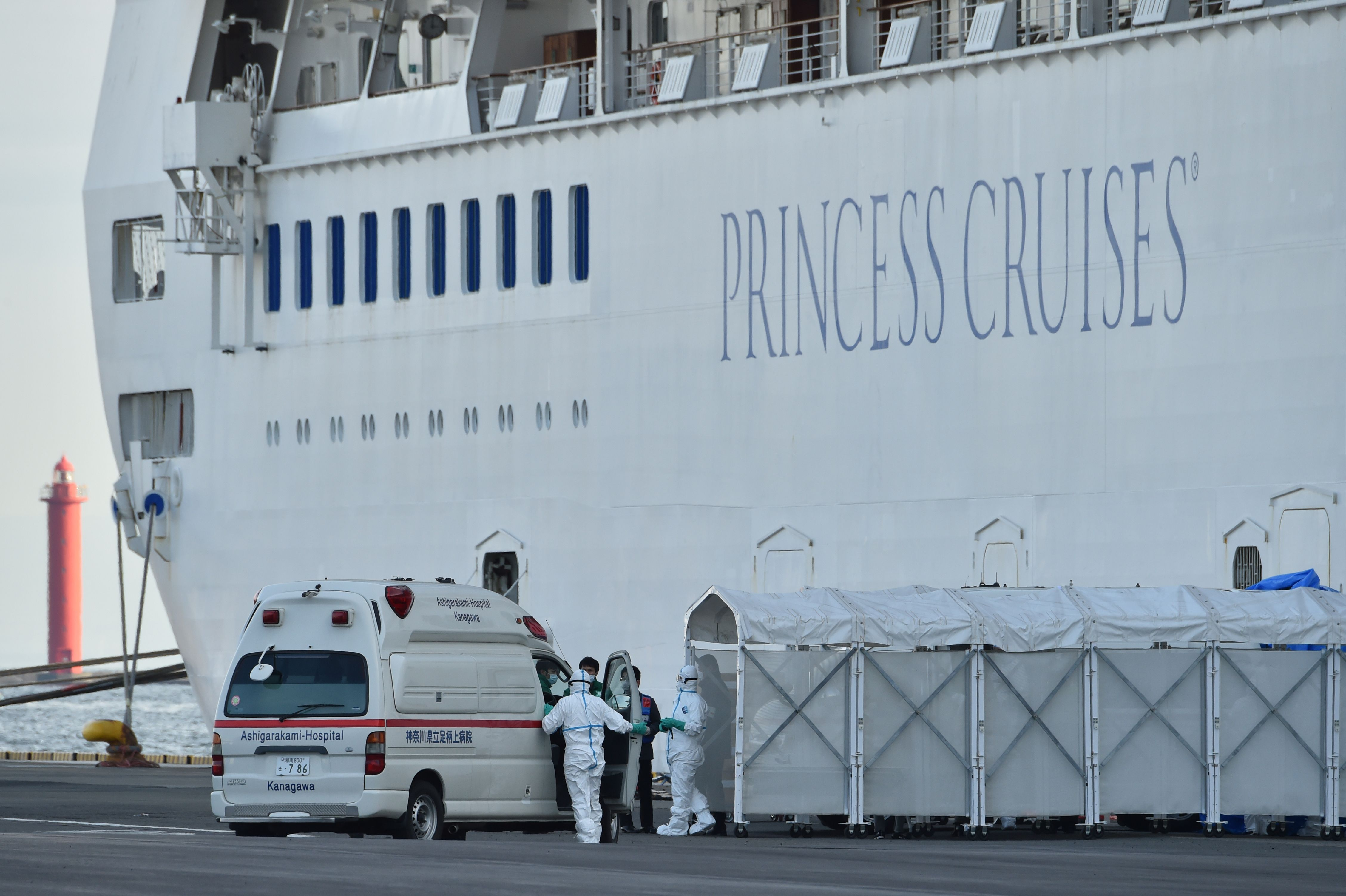 Personnel next to the Diamond Princess cruise ship in Yokohama, Japan, on February 7.