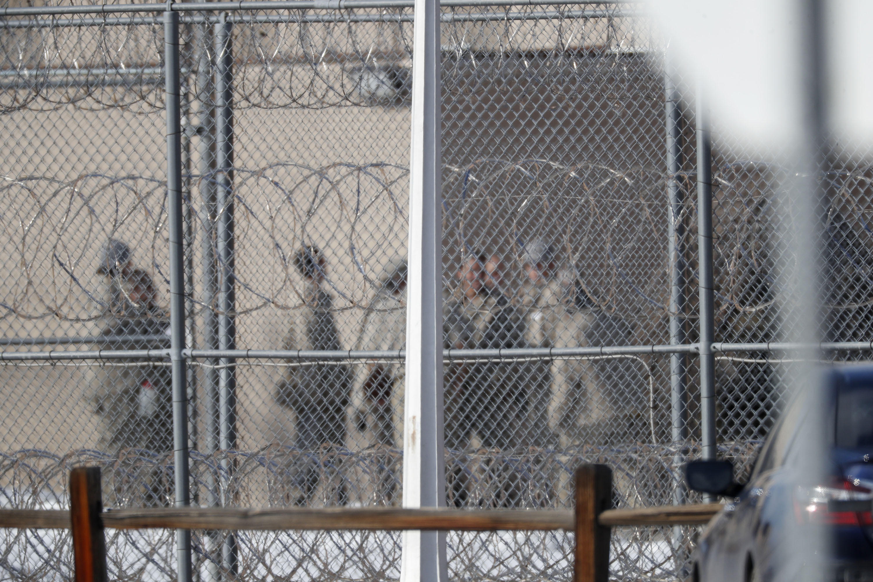 Prisoners stand outside a federal correctional institution in Englewood, Colorado, on February 18.