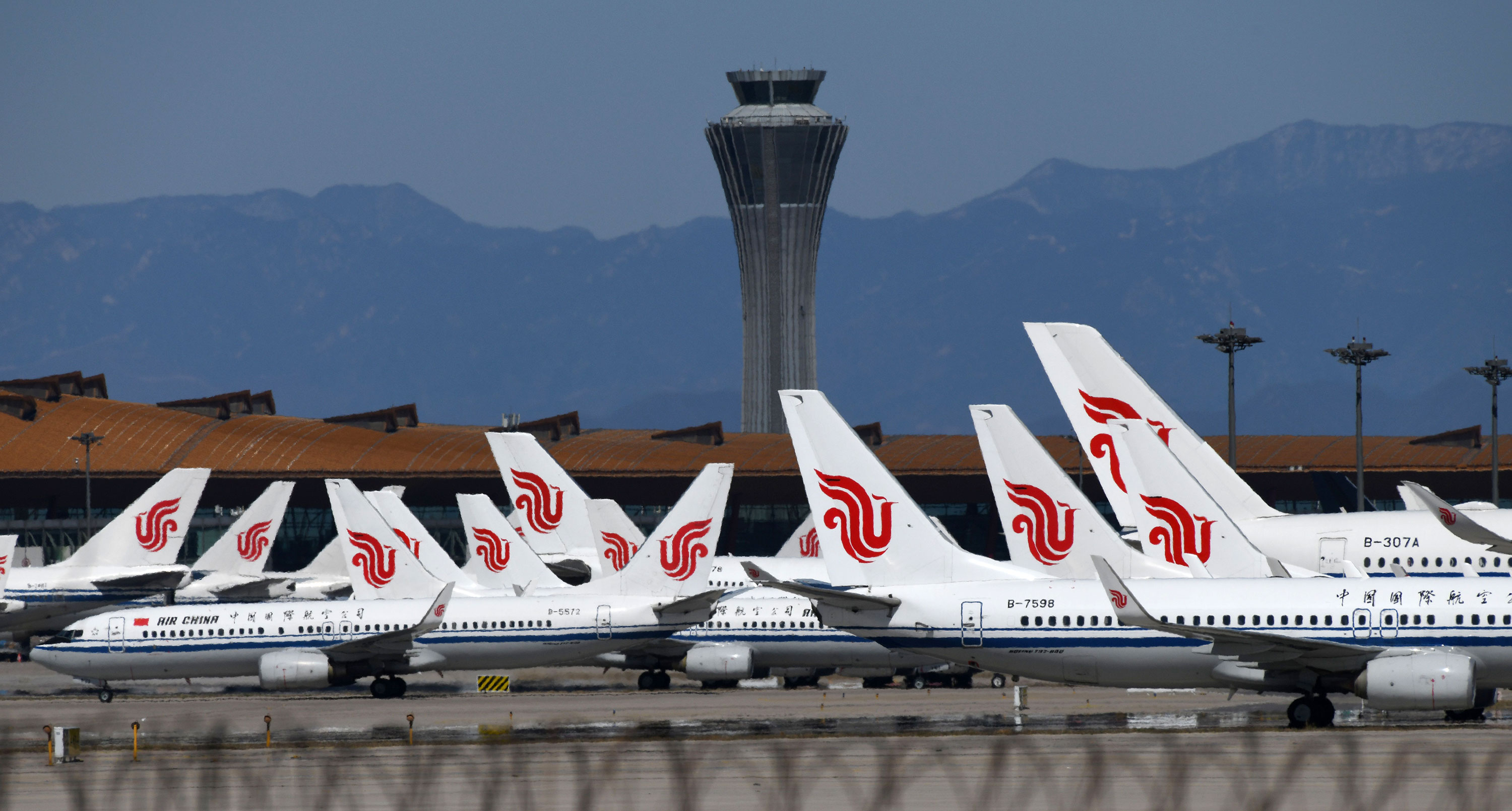 Air China planes sit on the tarmac at Beijing Capital Airport on March 27, in Beijing, China.