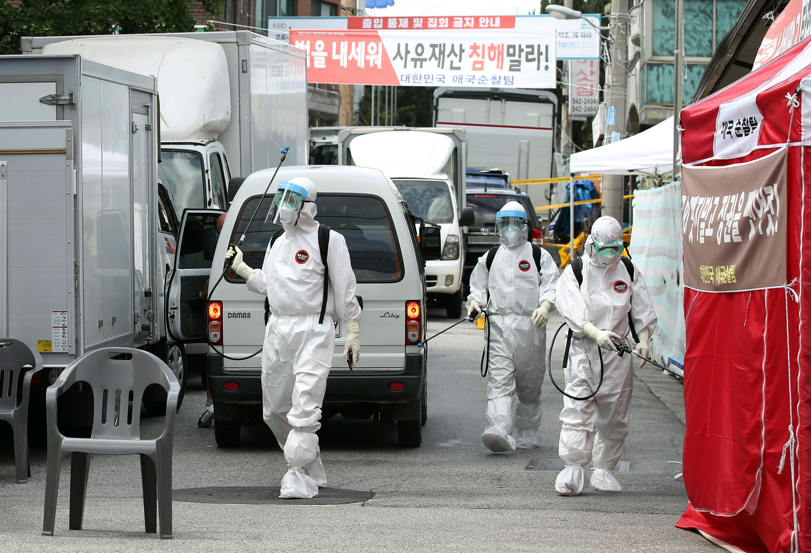 Public officials spray disinfectant near the Sarang-jeil church on August 16 in Seoul, South Korea.