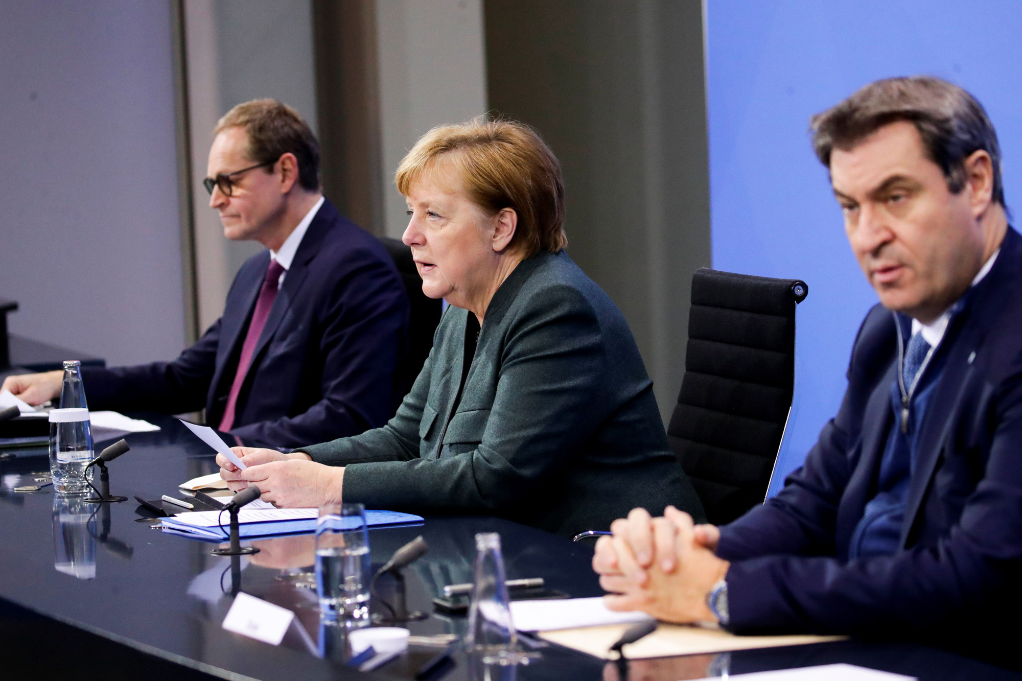 Berlin's Mayor Michael Mueller, left, German Chancellor Angela Merkel, center, and Bavaria's State Premier Markus Soeder attend a press conference at the Chancellery in Berlin on January 19.