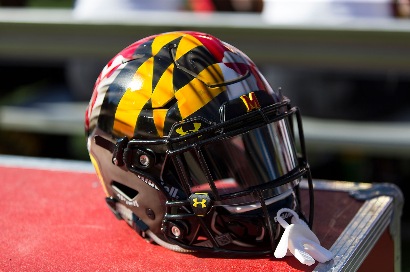 The University of Maryland has temporarily suspended its voluntary, individual training for the football program after nine individuals tested positive for Covid-19.