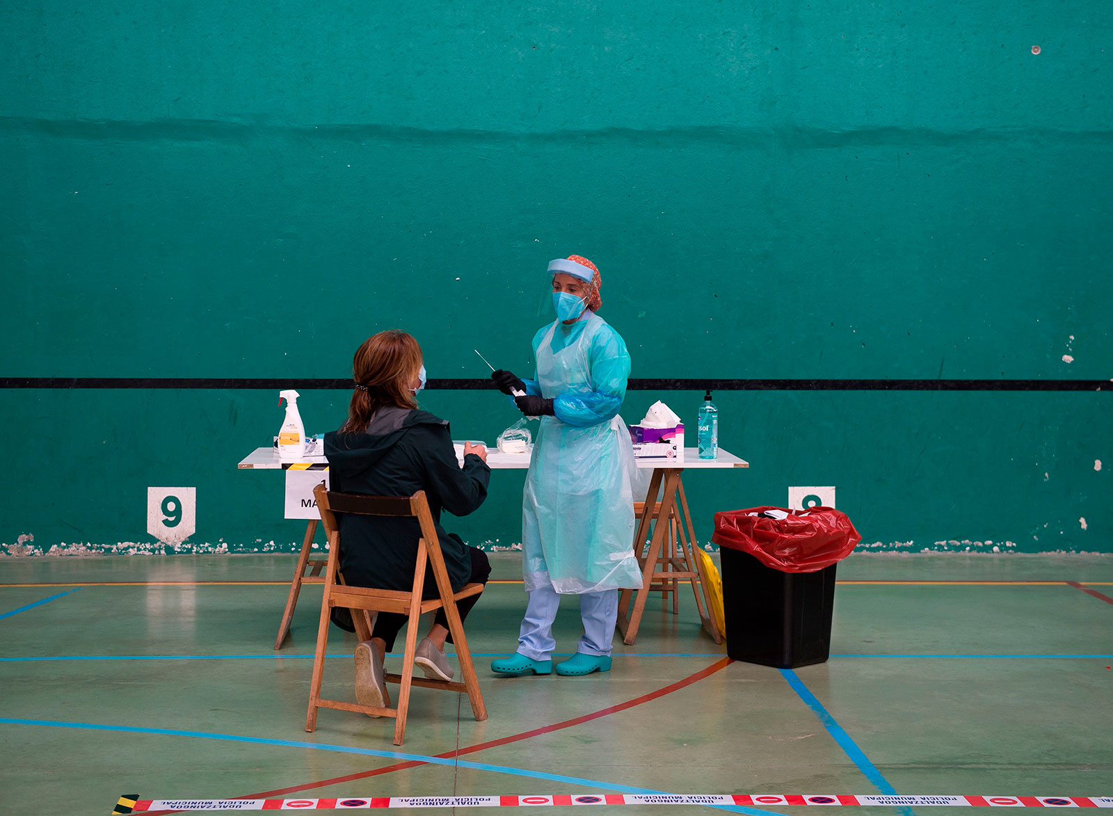 A healthcare worker collects a swab sample at a coronavirus testing center in Getaria, Spain, on July 15.