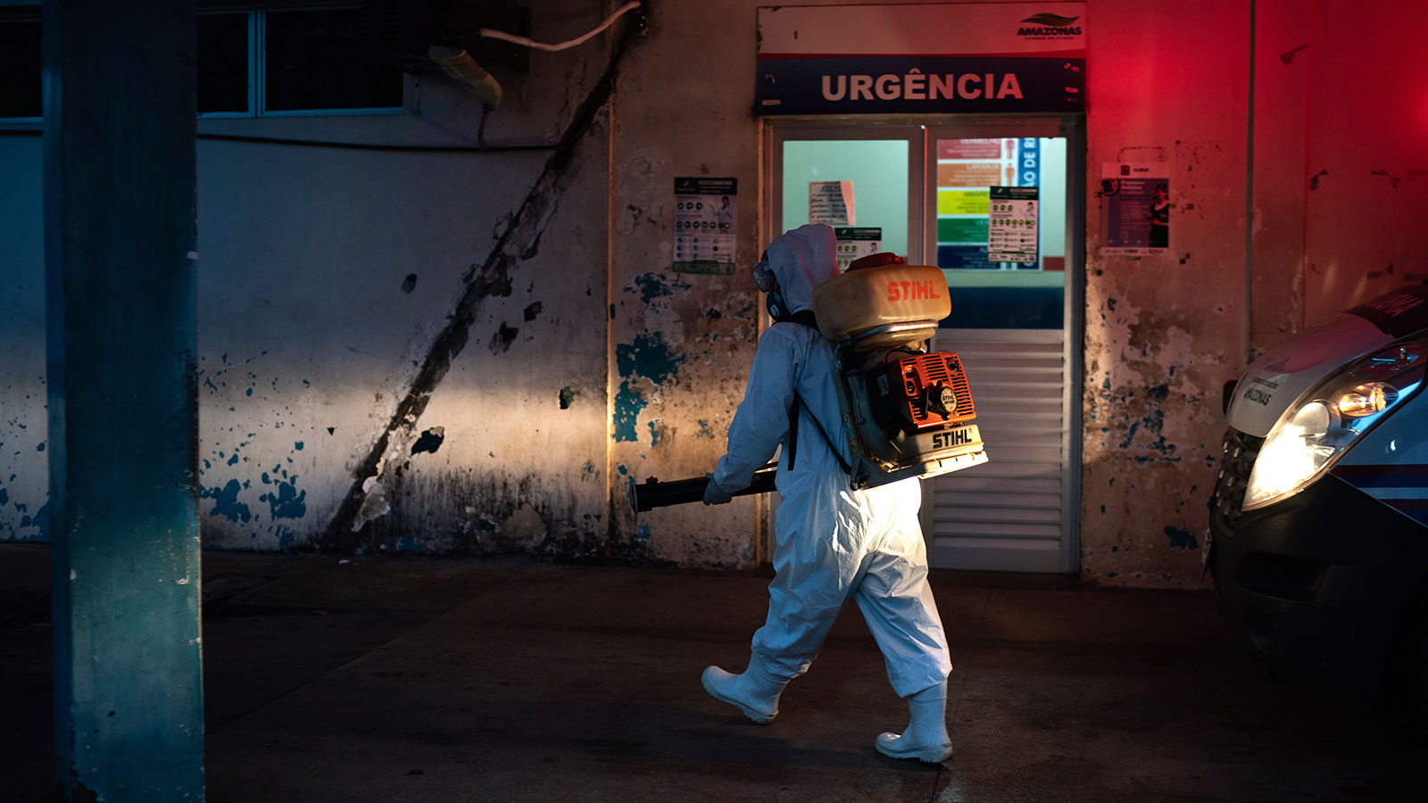 A worker sprays disinfectant to help contain the spread of the coronavirus outside a hospital in Manacapuru, Amazonas state, Brazil on June 2.