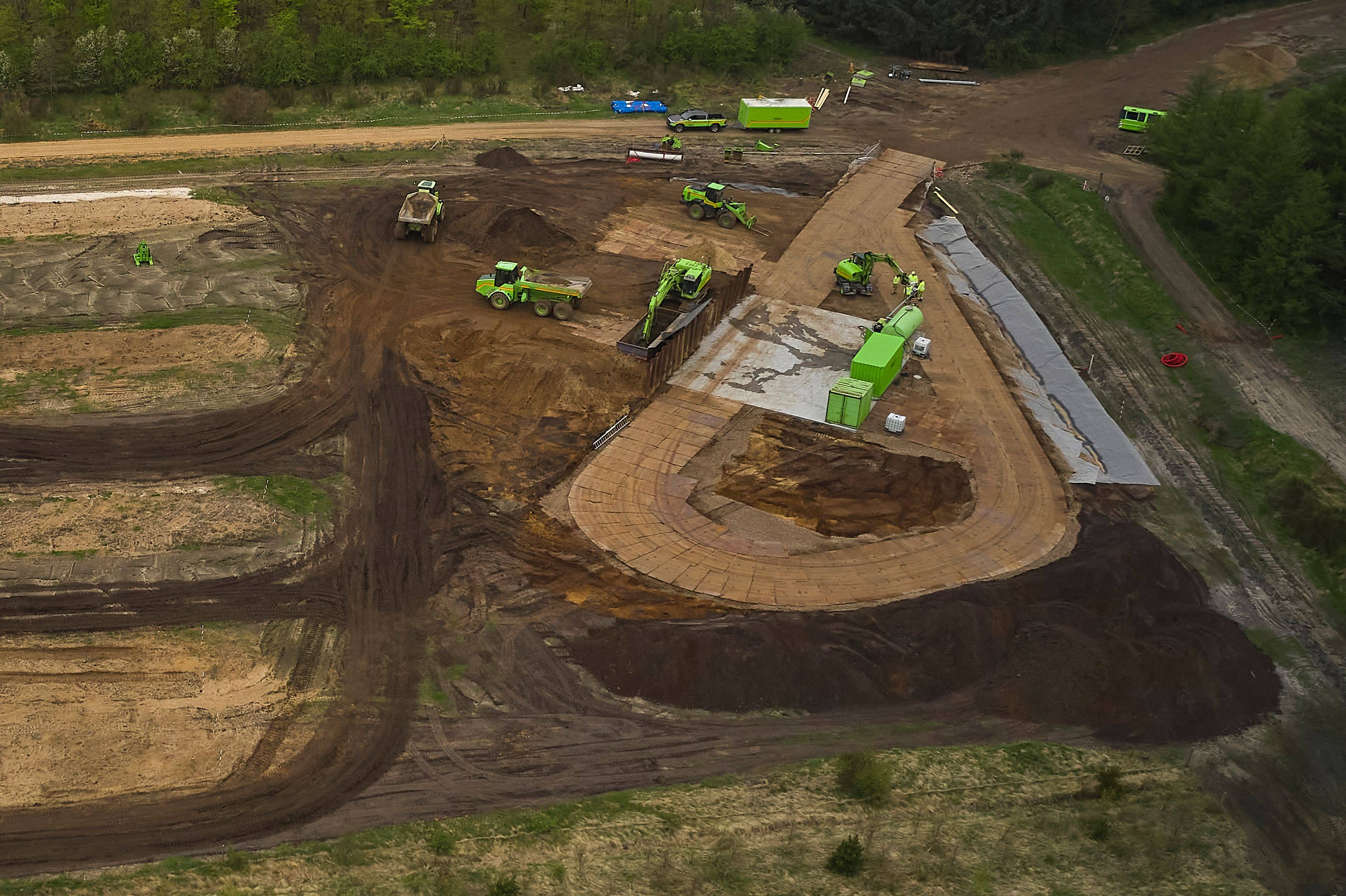 Buried mink are excavated during a trial excavation at a military area close to Norre Felding, Holstebro, in Denmark, on May 13.
