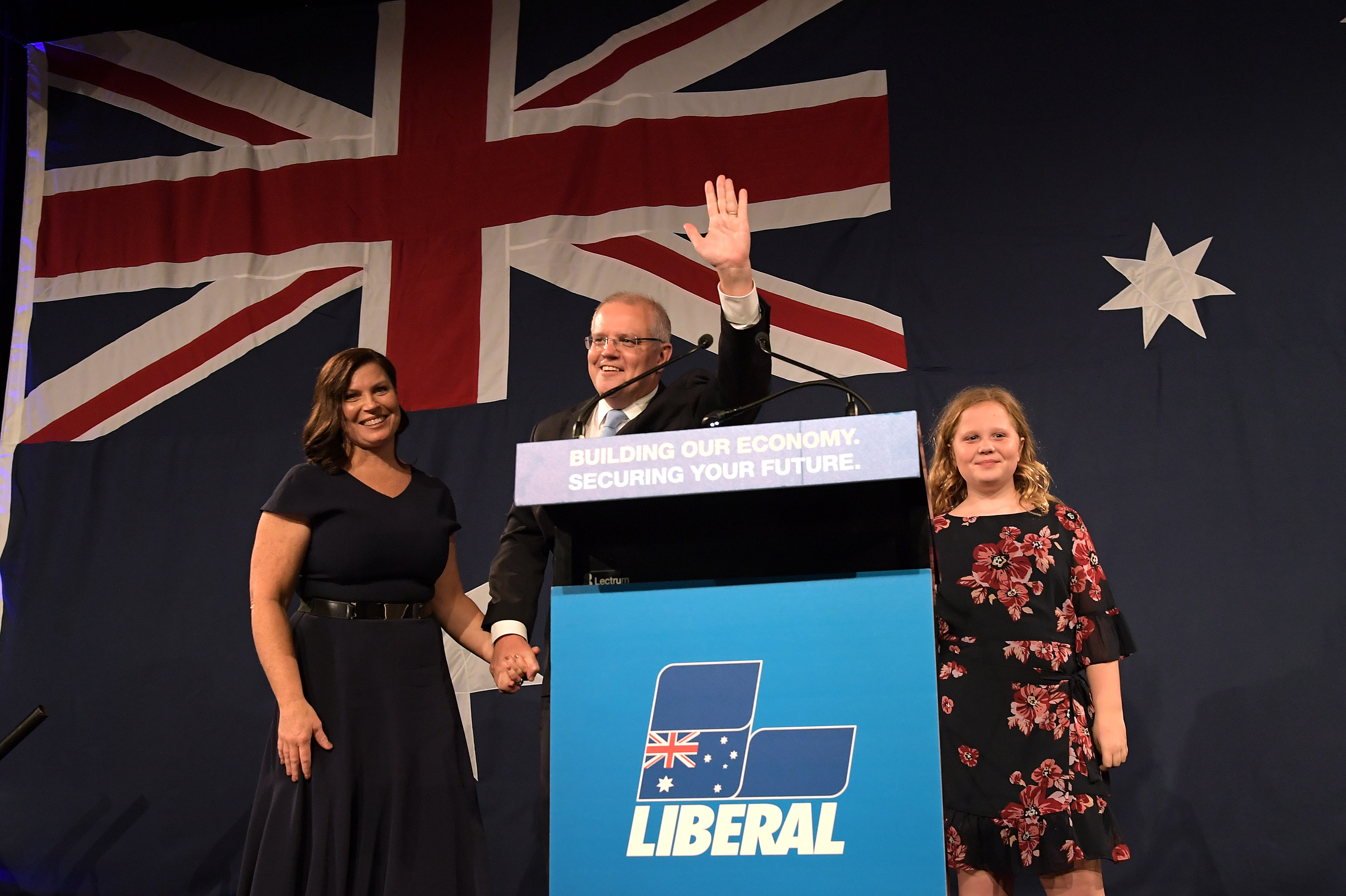 Prime Minister Scott Morrison, flanked by his wife Jenny Morrison and daughters Lily Morrison and Abbey Morrison, delivers his victory speech in Sydney on Saturday.