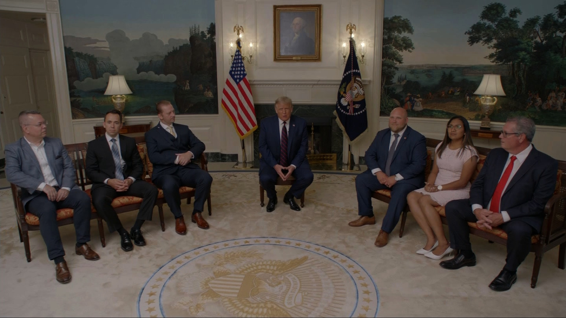 President Trump sits with former hostages and detainees who were freed during his administration.