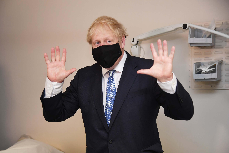 British Prime Minister Boris Johnson visits Tollgate Medical Centre in London, on Friday, July 24.