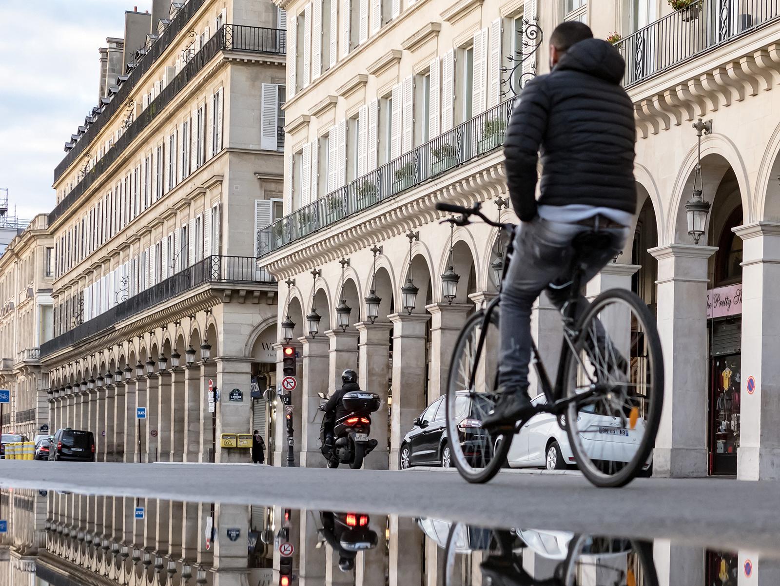 A cyclist rides on the Rue de Rivoli in Paris on November 23.