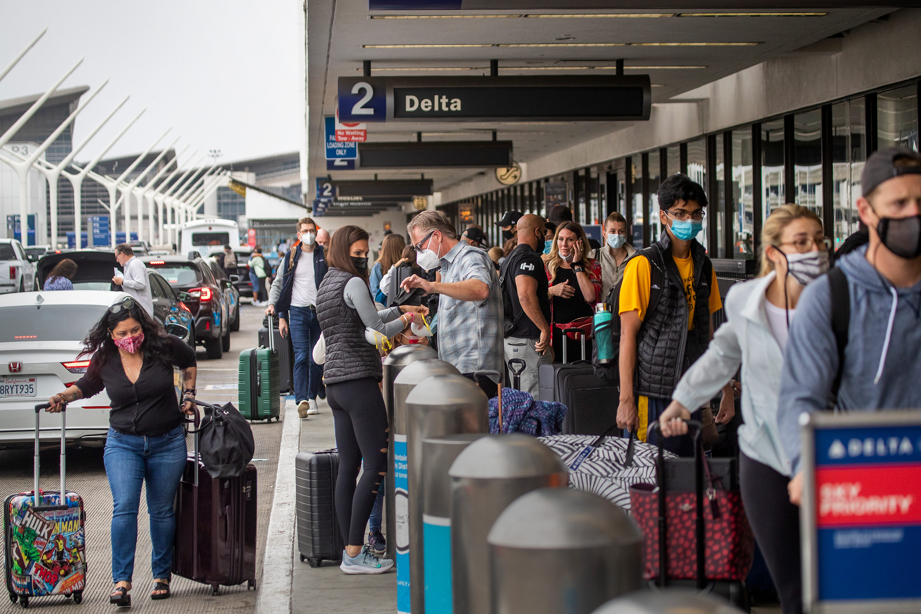 Travelers wait to check in for their flights at Los Angeles International Airport, on Friday, May 28.