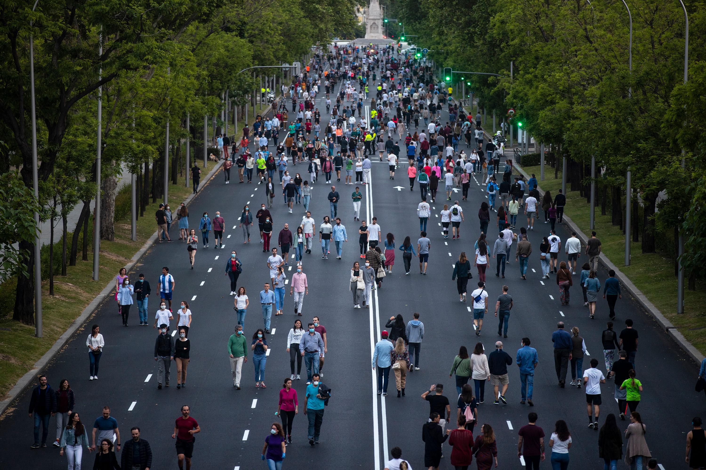 People walk along Paseo de la Castellana in Madrid on May 9.
