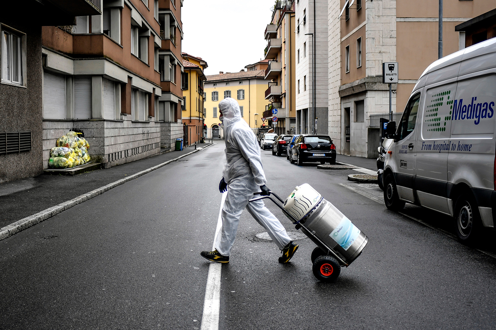 A staffer delivers a medical oxygen tank to coronavirus patients being treated at home in Bergamo on March 31.