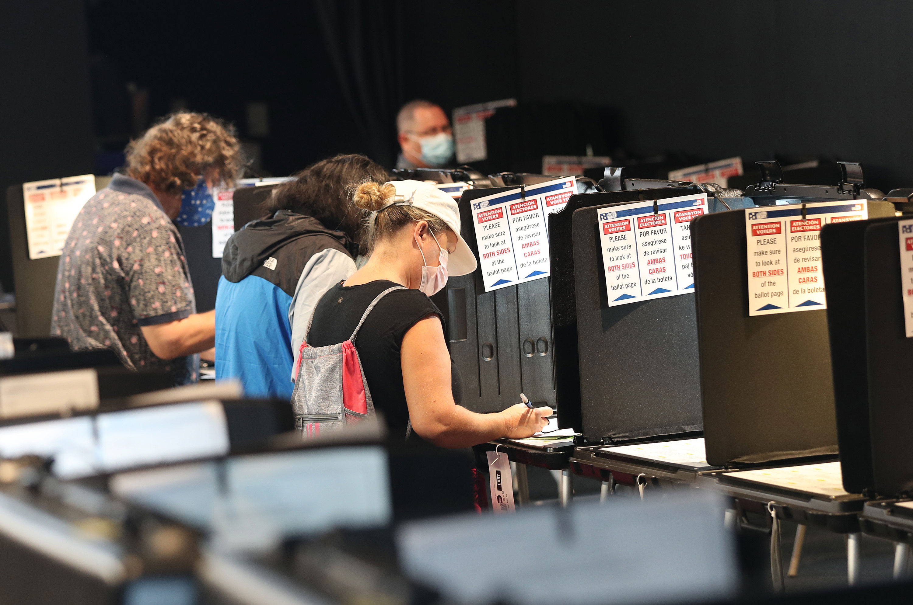 Voters fill out their ballots in Miami on October 19.
