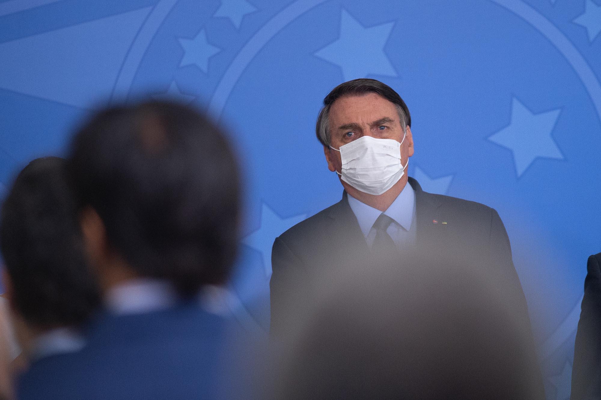 President of Brazil Jair Bolsonaro looks on during the ceremonyin which Eduardo Pazuello takes office as Minister ofHealthamid the coronavirus pandemic on September 16, in Brasilia.