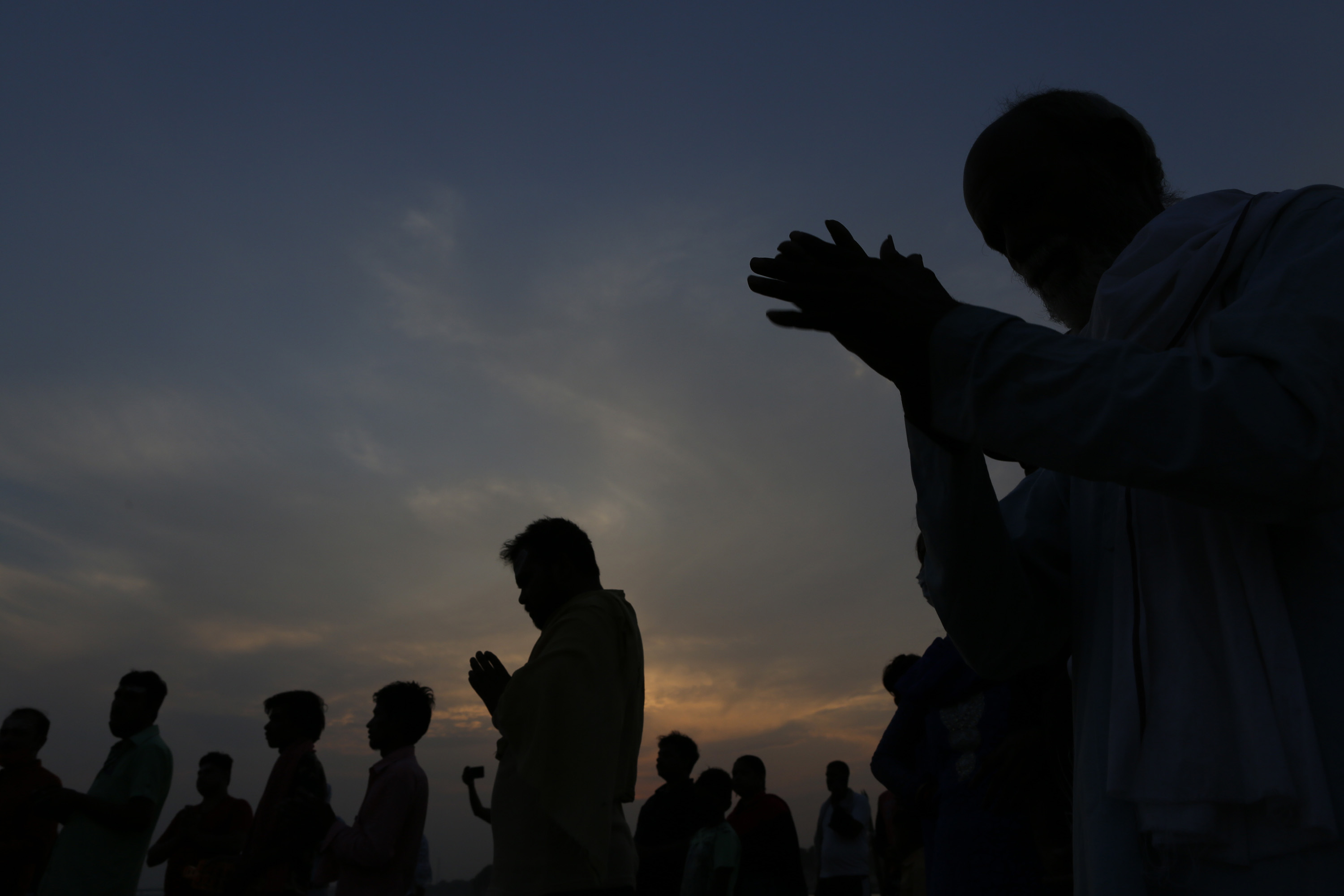 Hindu devotees offer evening prayers in the River Ganges in Prayagraj, India, on June 1.