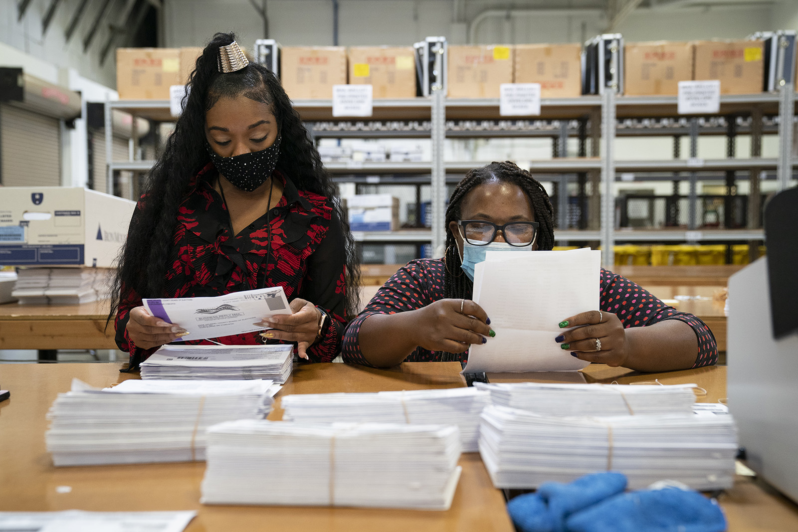 Working in bipartisan pairs, canvassers process mail-in ballots in a warehouse at the Anne Arundel County Board of Elections headquarters on October 7, in Glen Burnie, Maryland.