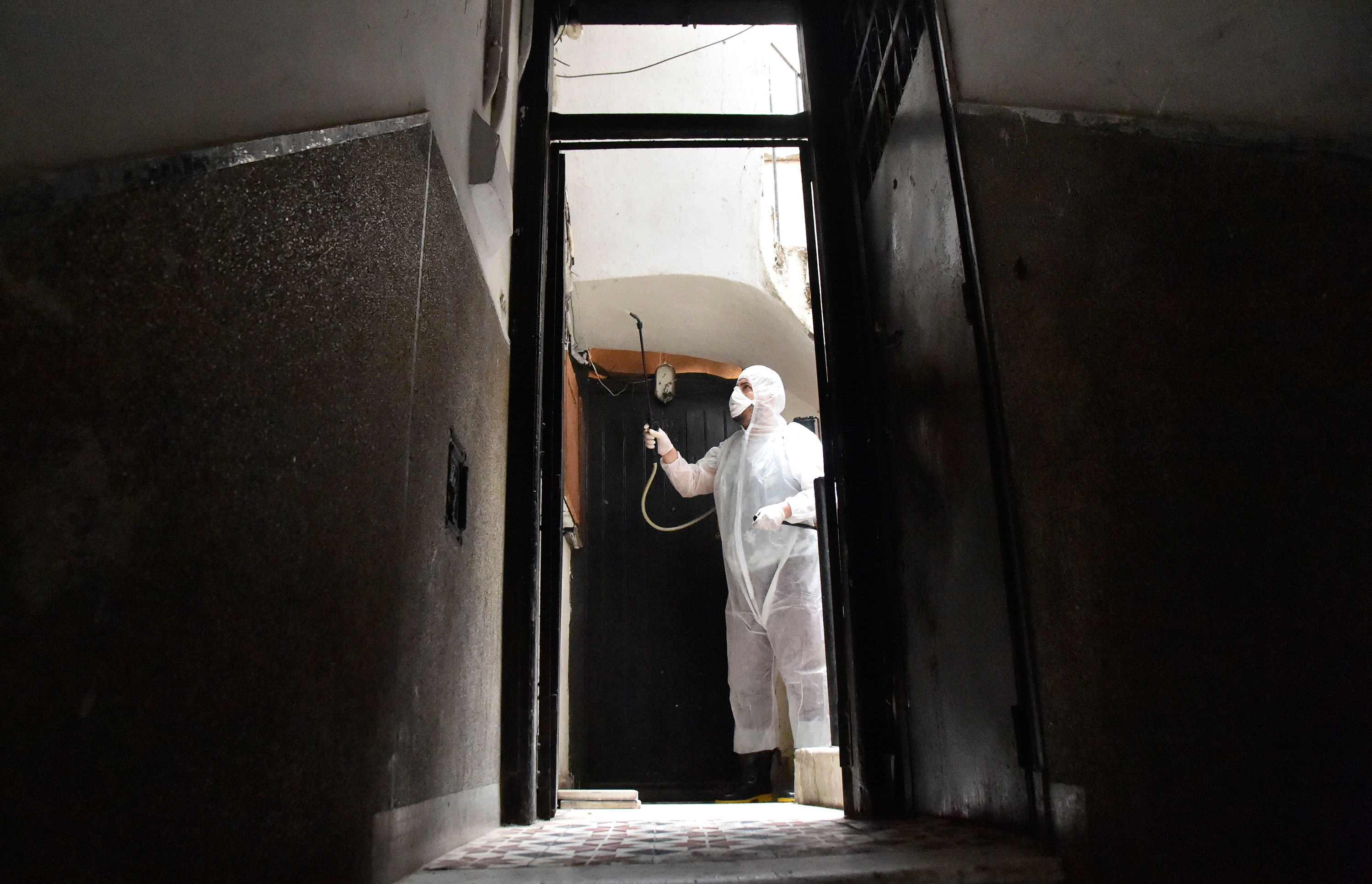 A worker disinfects a building in Algiers, Algeria on March 20.