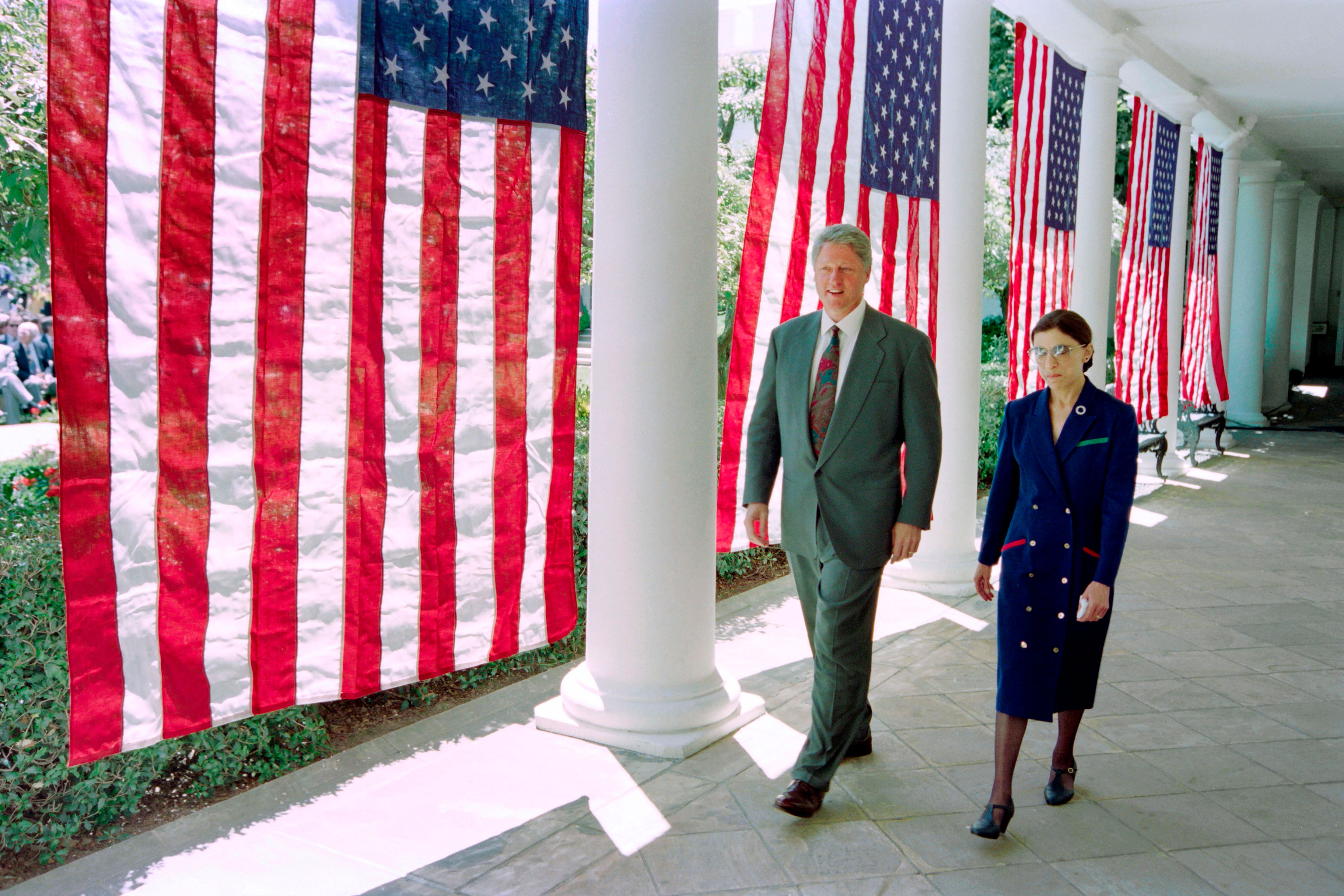 Former President Bill Clinton walks with Justice Ruth Bader Ginsburg on the way to a press conference at the White House on June 14, 1993.