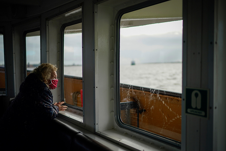 A passenger on a ferry on November 04, 2020 in Liverpool, England.