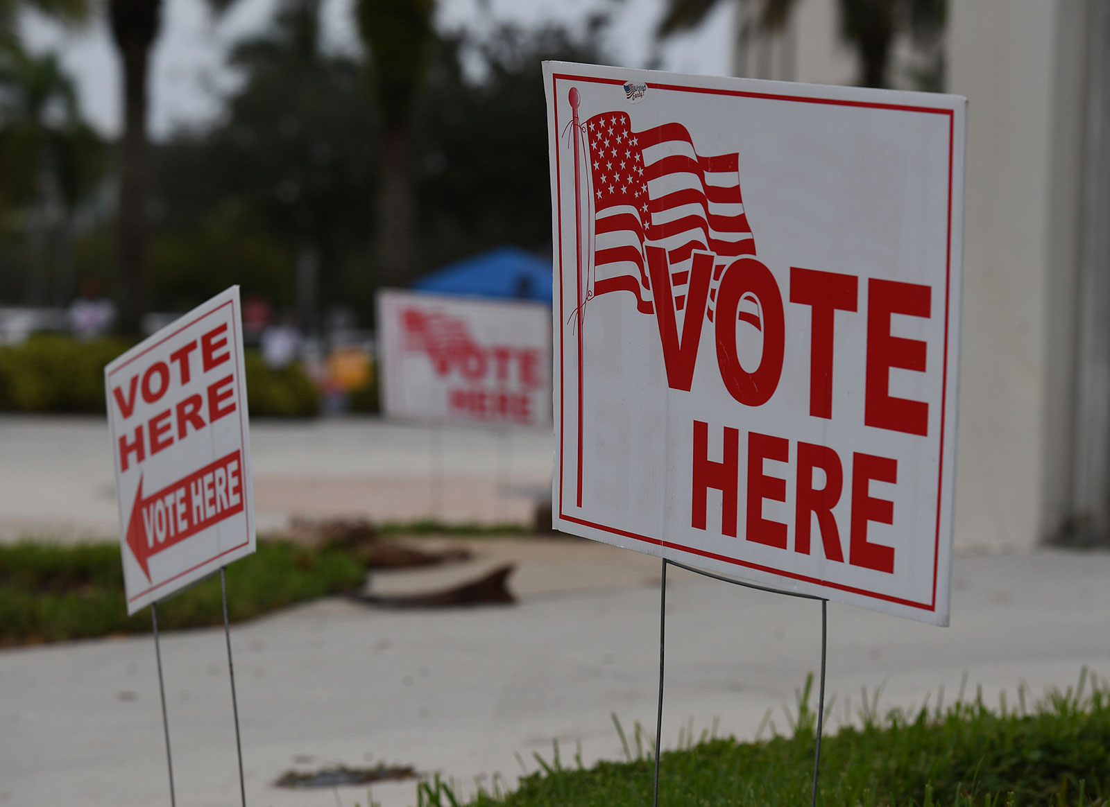 Signs are seen outside of a polling location in Coral Springs, Florida, on October 19.