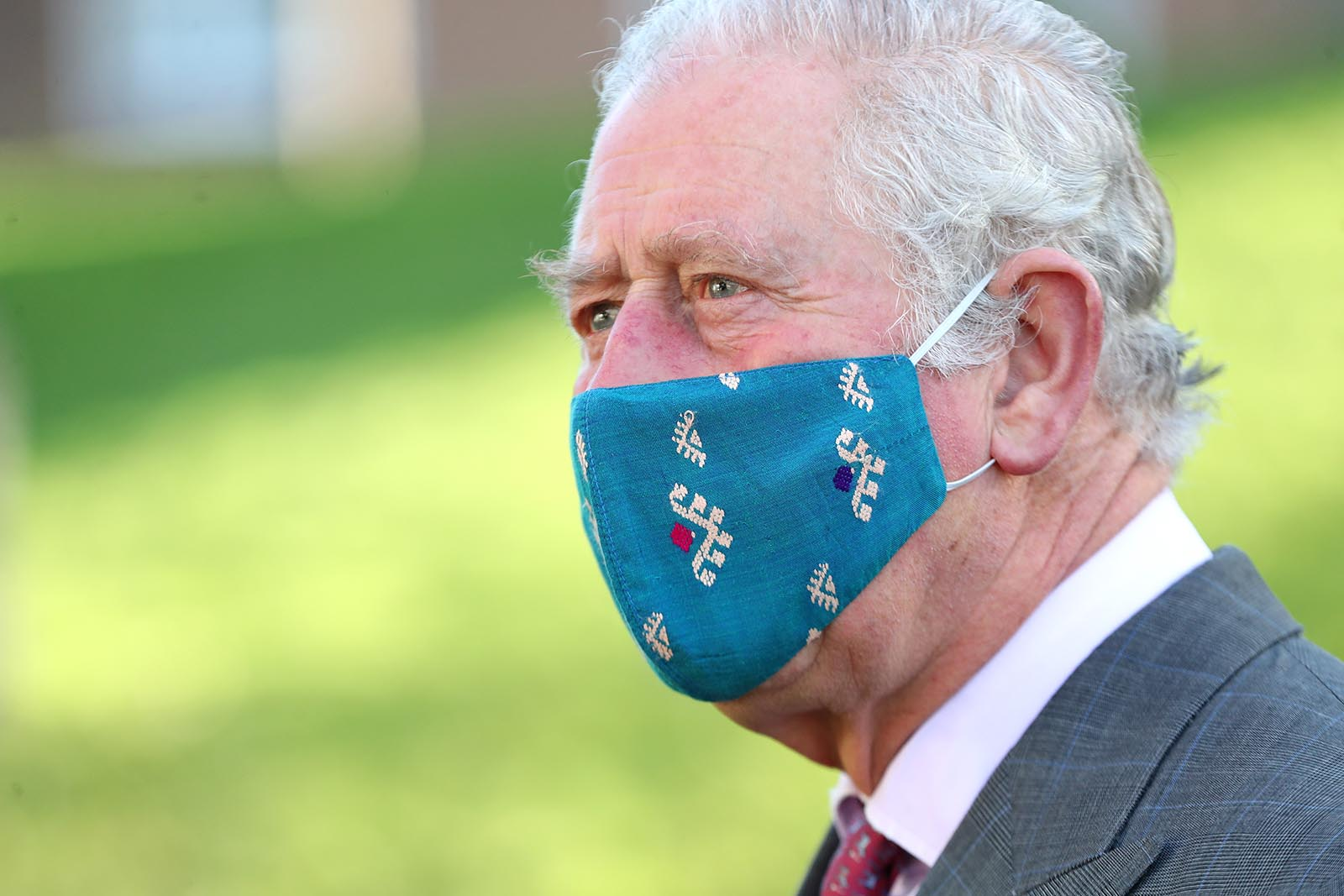 Prince Charles wears a face mask during a visit to Gloucestershire Vaccination Centre at Gloucestershire Royal Hospital on December 17, 2020 in Gloucester, England.