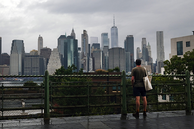 A man looks out at the Manhattan skyline in a Brooklyn neighborhood on September 29, 2020 in New York City.