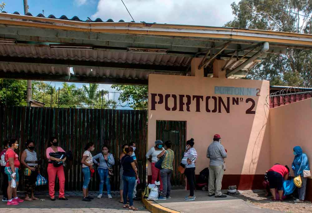Relatives of patients of Aleman-Nicaraguense Hospital, which cares for people infected with Covid-19, wait to enter the hospital in Managua, Nicaragua, on June 1.