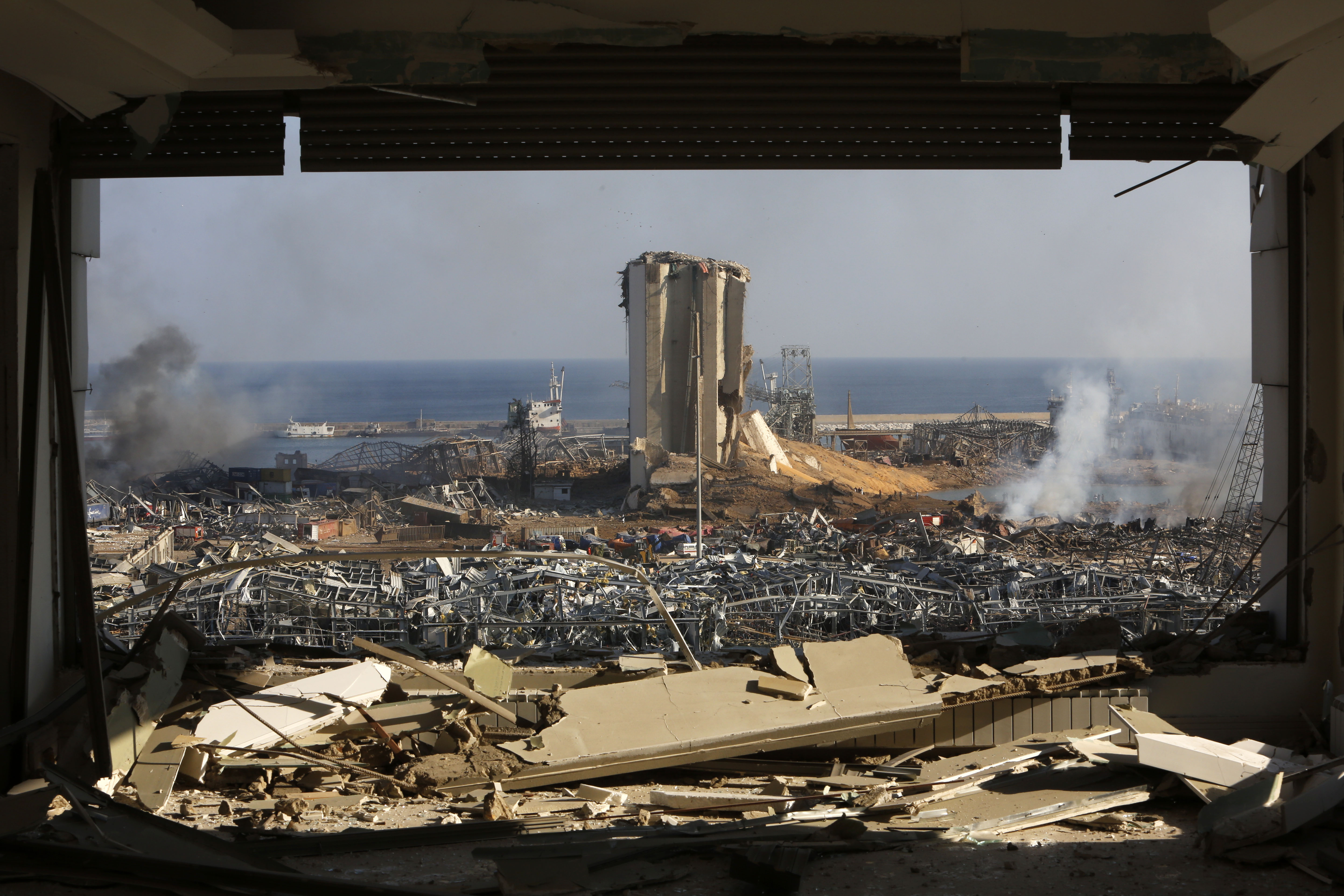 Smoke rises above destroyed buildings at Beirut's port on August 5.
