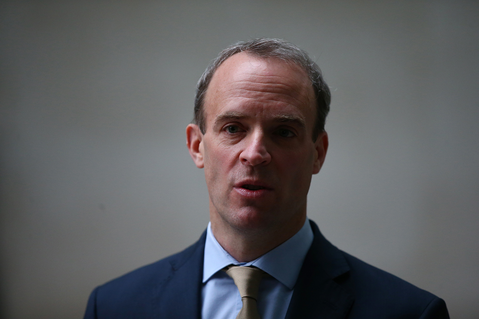 Britain's Foreign Secretary and First Secretary of State Dominic Raab leaves the BBC Television Centre after appearing on The Andrew Marr Show at November 29, 2020 in London, England.