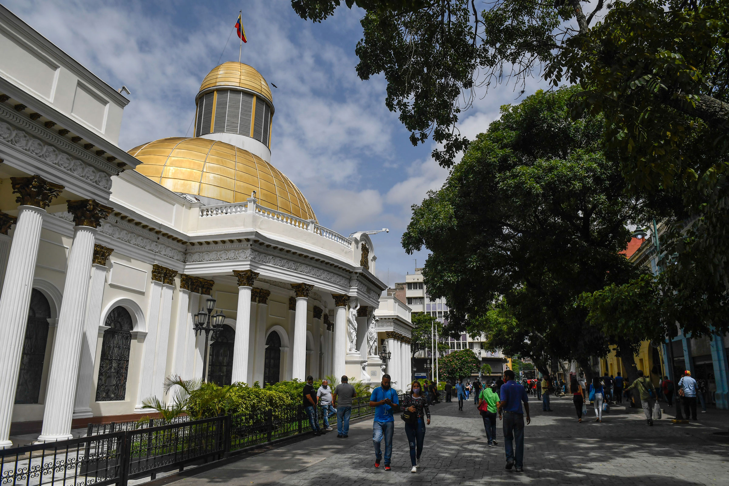 People walk past the National Assembly building in Caracas, Venezuela, on Tuesday.