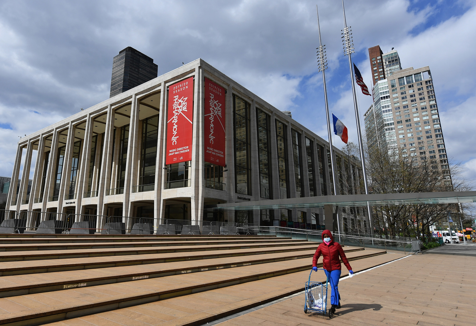 A woman pushes a cart outside Lincoln Center and the New York Philharmonic on April 16 in New York City.