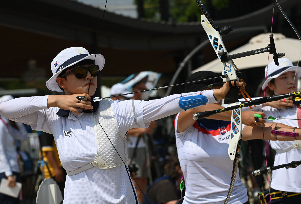 An San (left) of South Korea competes in the women's individual ranking round at Yumenoshima Park Archery Field on July 23.