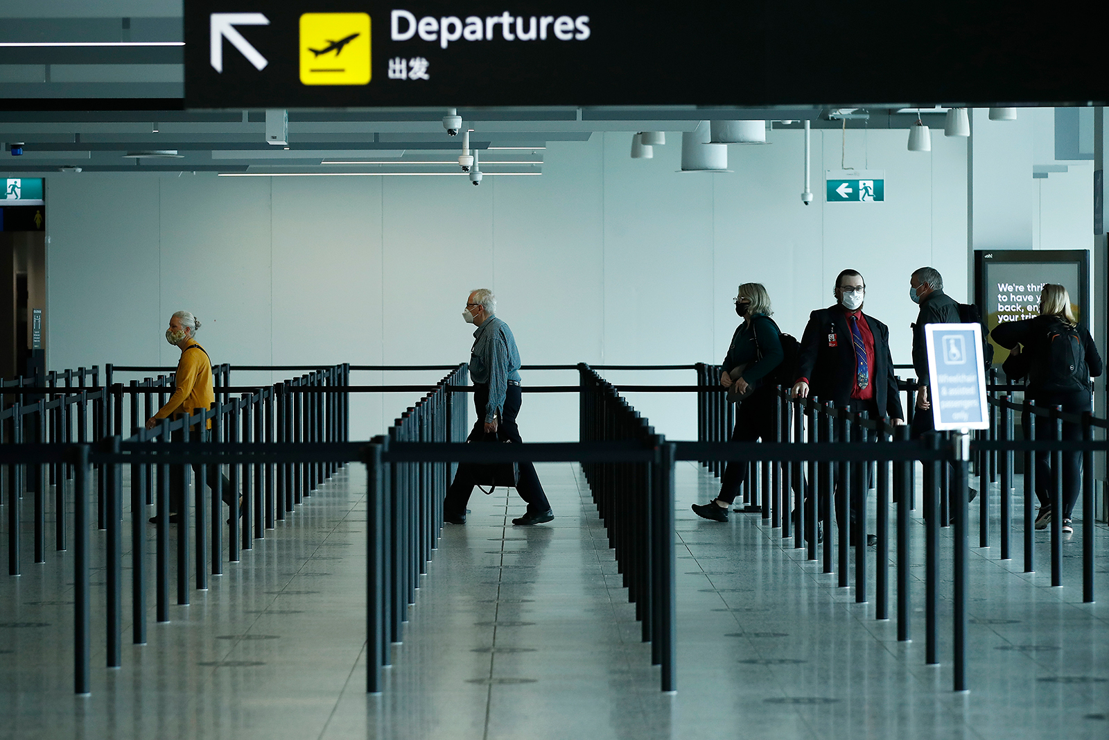 People are seen at Melbourne airport checking in for flights to New South Wales on November 23.