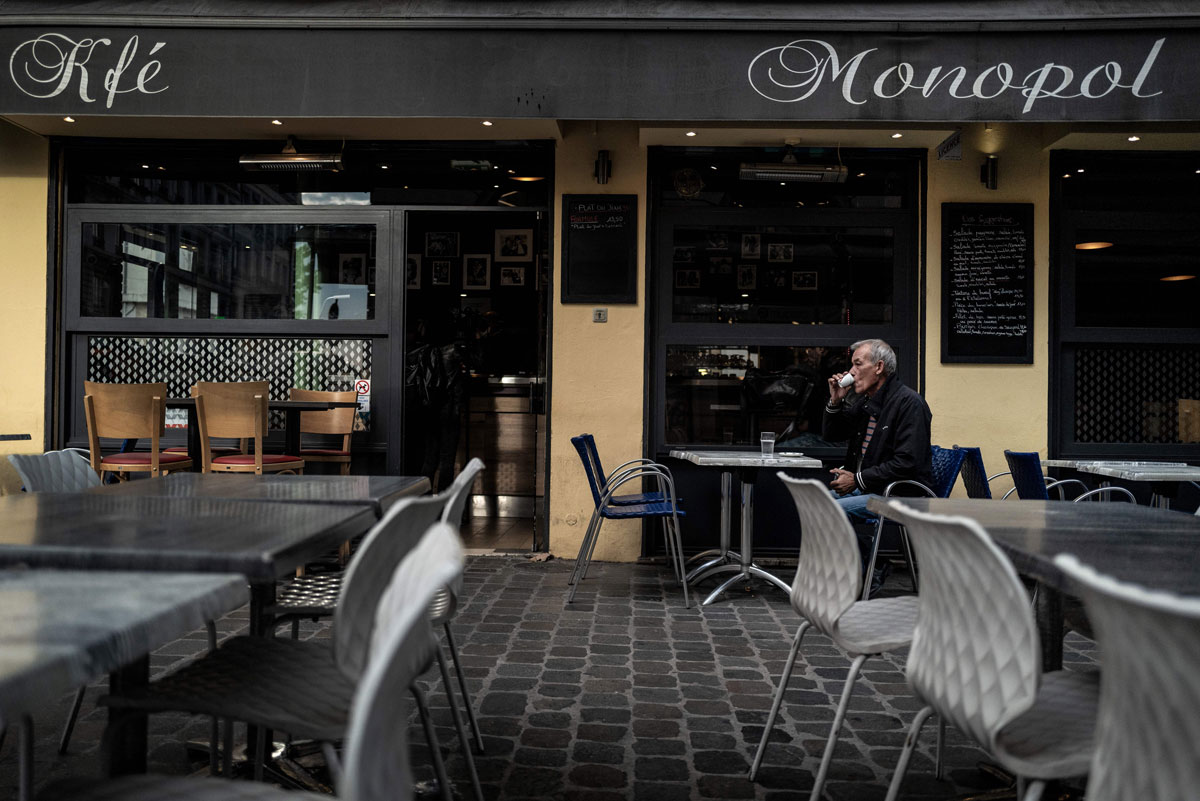 A customer drinks a coffee on a cafe terrace on October 9 in Lyon after the city was placed on maximum coronavirus alert. Four French cities including Lyon are placed on maximum coronavirus alert, joining Paris and other metropolises where bars have been shuttered in an increasingly urgent bid to brake a fast-accelerating outbreak of Covid-19.