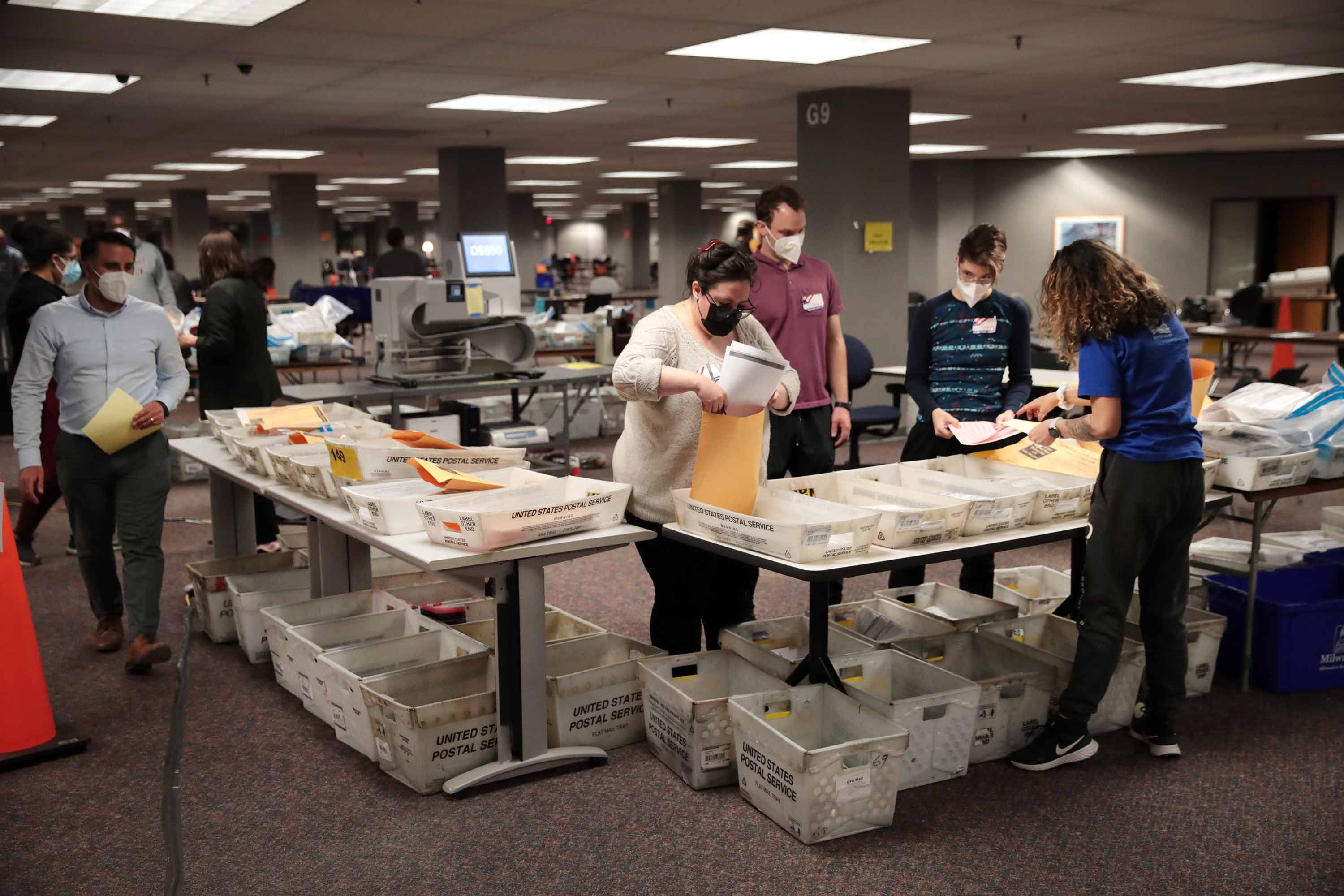 Election officials count absentee ballots in Milwaukee, Wisconsin, early on November 4.
