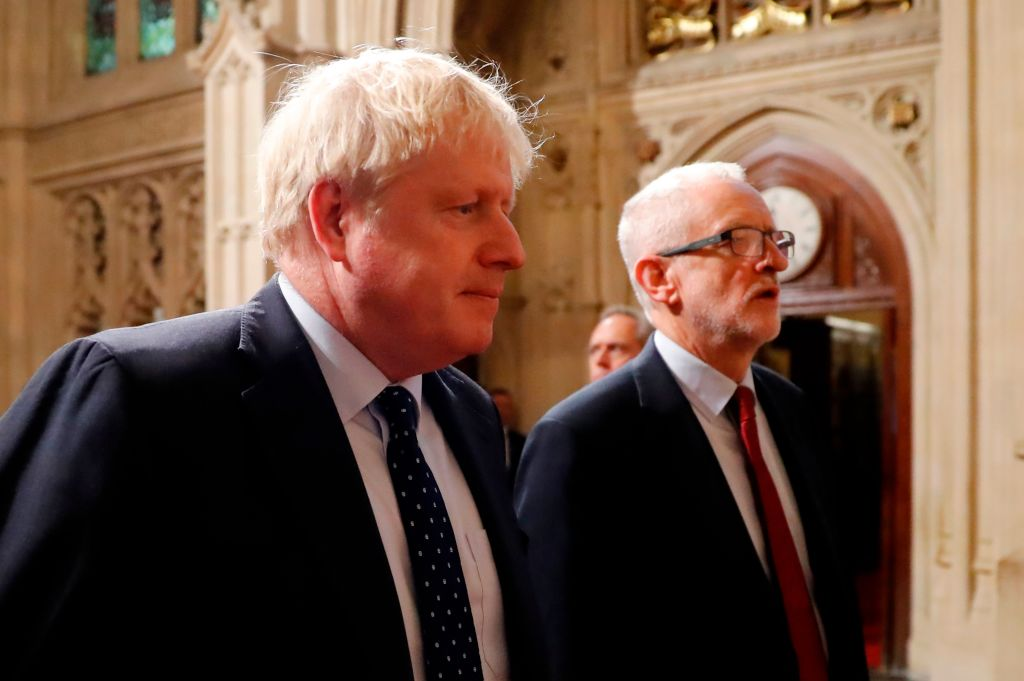 Boris Johnson and Jeremy Corbyn walk to the House of Lords.